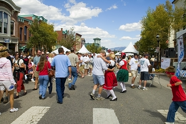 Large crowd of people celebrating and dancing the polka at an Oktoberfest celebration