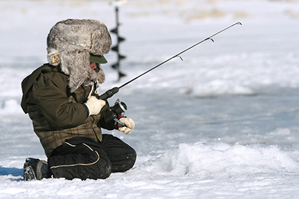 Boy ice fishing