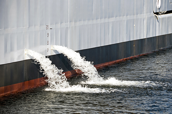 Ballast water pouring from ship