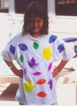 Child with leaf print t-shirt